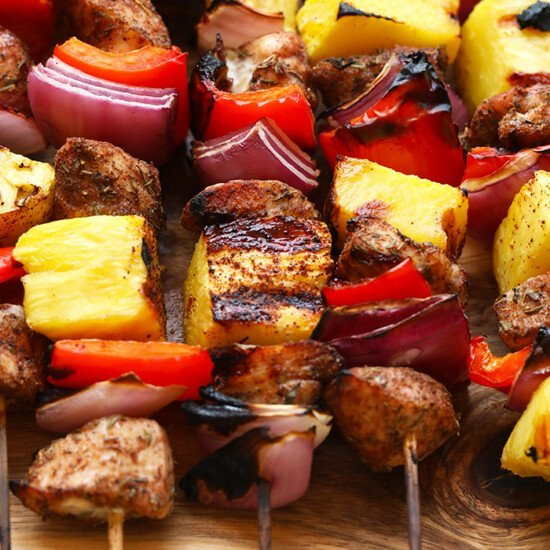 Ready to be obsessed with these Grilled Pineapple and Jerk Chicken Kabobs? Skewer this jerk chicken up with some peppers, onions, and fresh pineapple for a glorious and healthy chicken kabobs recipe!