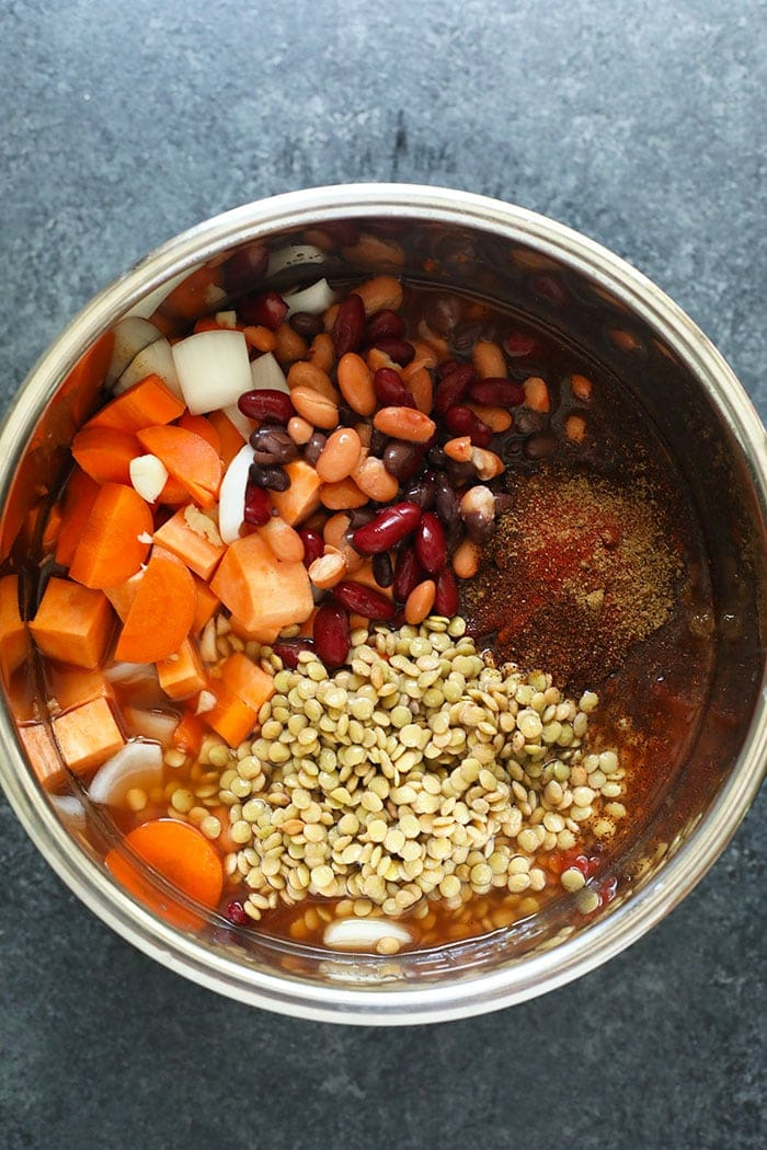 Instant Pot vegan chili ingredients placed in the Instant Pot
