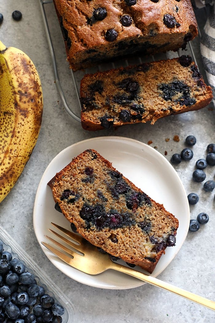 Slice of blueberry banana bread on a plate
