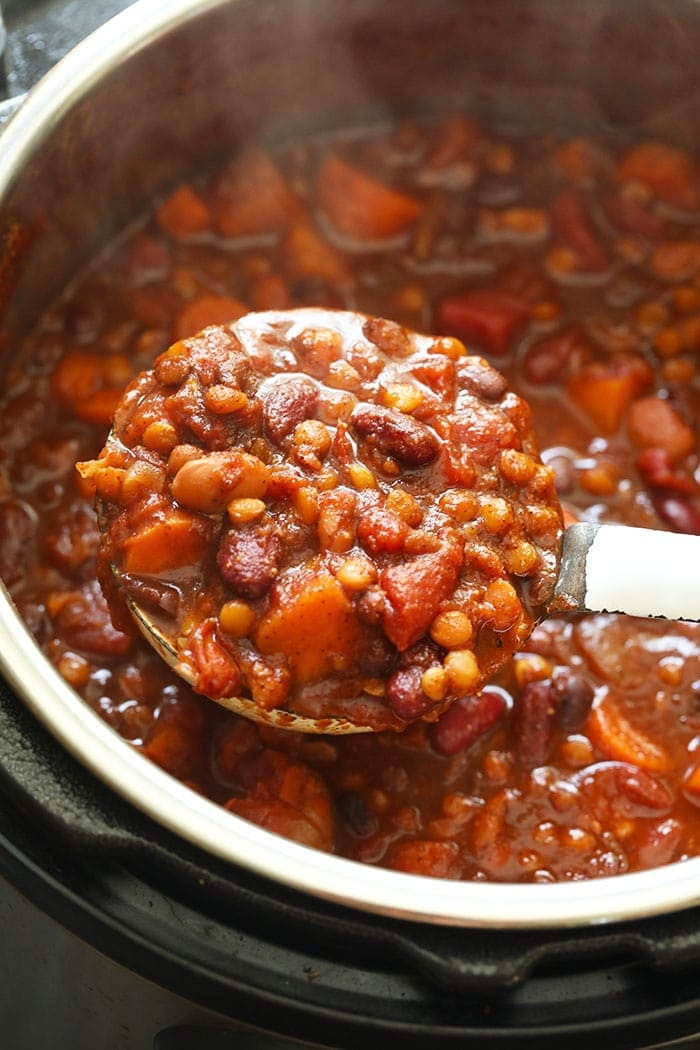 Instant Pot Vegan Chili on a ladle in the Instant Pot