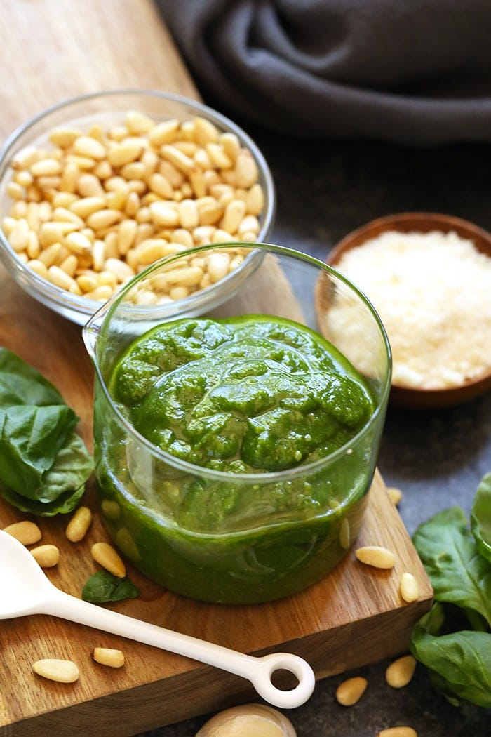 Pesto in a jar ready to be added to meal prep chicken
