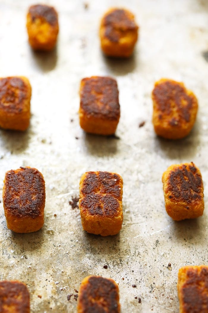 Baked sweet potato tater tots on a baking sheet