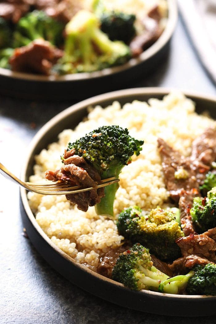 instant pot beef and broccoli on a fork ready to be eaten