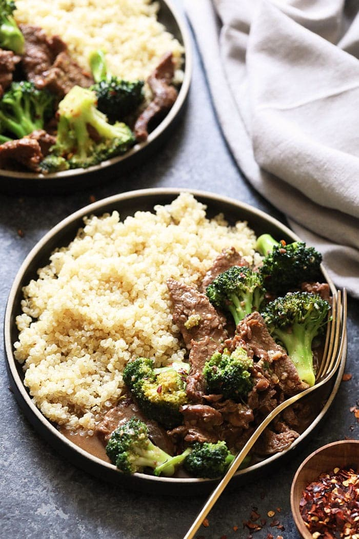 instant pot beef and broccoli on a plate with quinoa