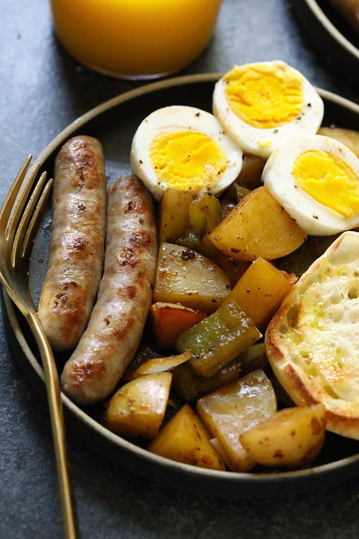 Potatoes, sausage and eggs on a plate