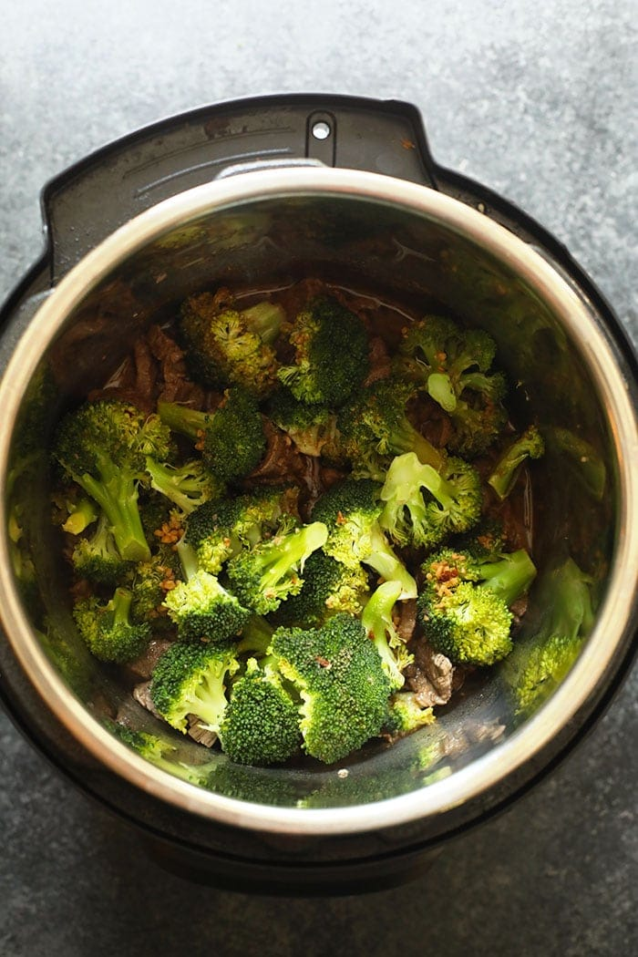 beef and broccoli in the instant pot ready to be sauteed