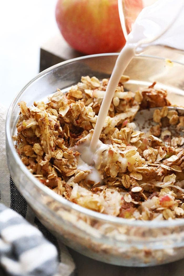 apple cinnamon overnight oats being mixed in a bowl