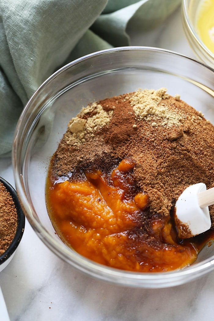 A bowl of pumpkin pie bar filling ingredients
