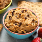 This chocolate chip edible cookie dough dip tastes exactly like Tollhouse cookie dough! It's made with a base of garbanzo beans, cashew butter, vanilla extract and sweetened with maple syrup. Throw in a handful of mini chocolate chips and you've got yourself one heck of a healthy edible cookie dough recipe!