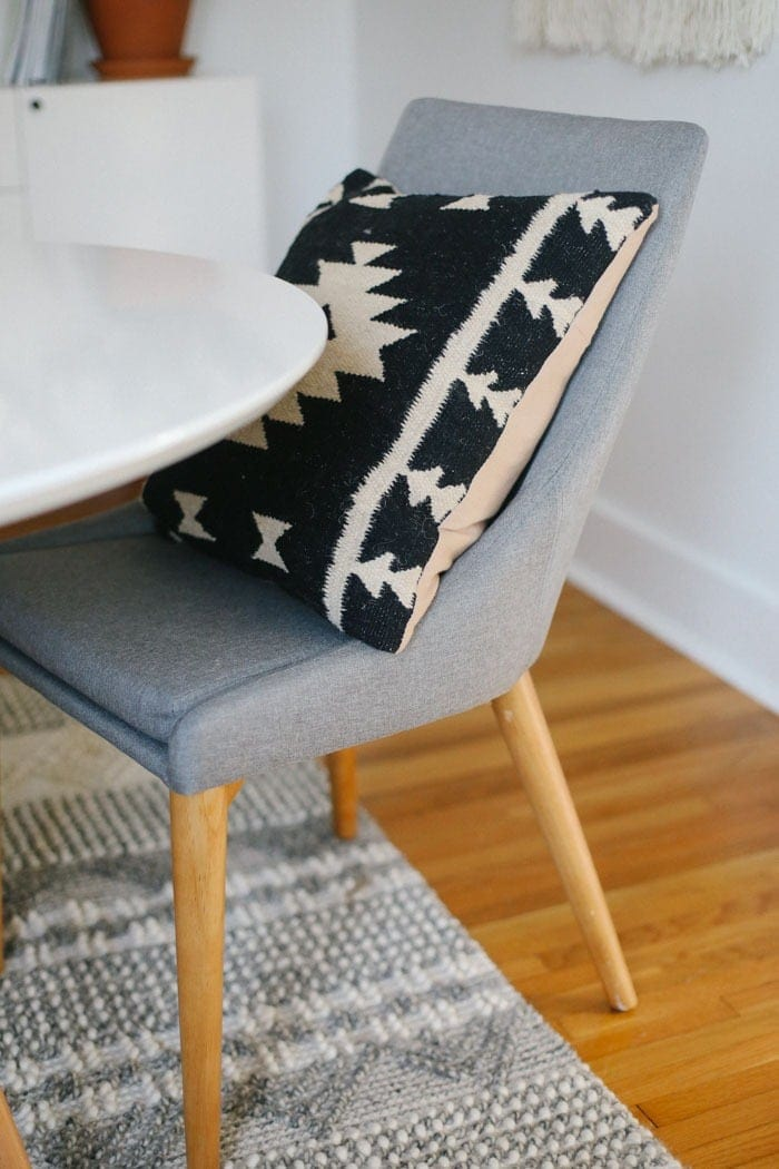 Mid-Century grey chair with aztec pillow
