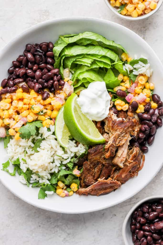 carnitas bowl with street corn salad
