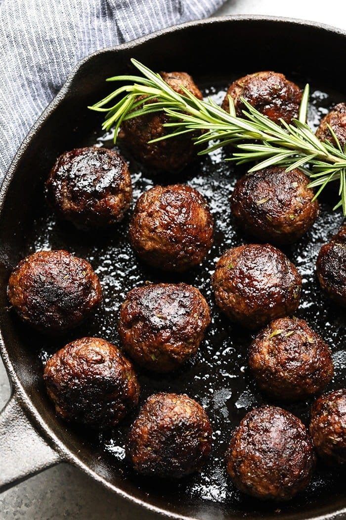 Rosemary Thyme Balsamic Meatballs in a cast iron pan