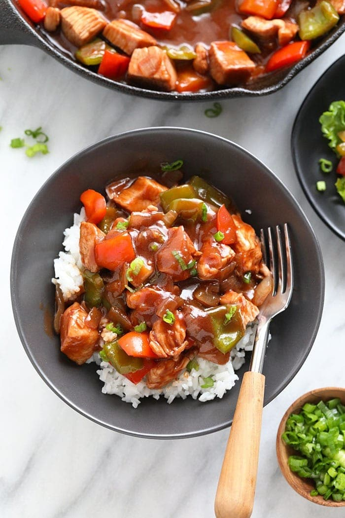healthy sweet and sour chicken recipe in a bowl with rice