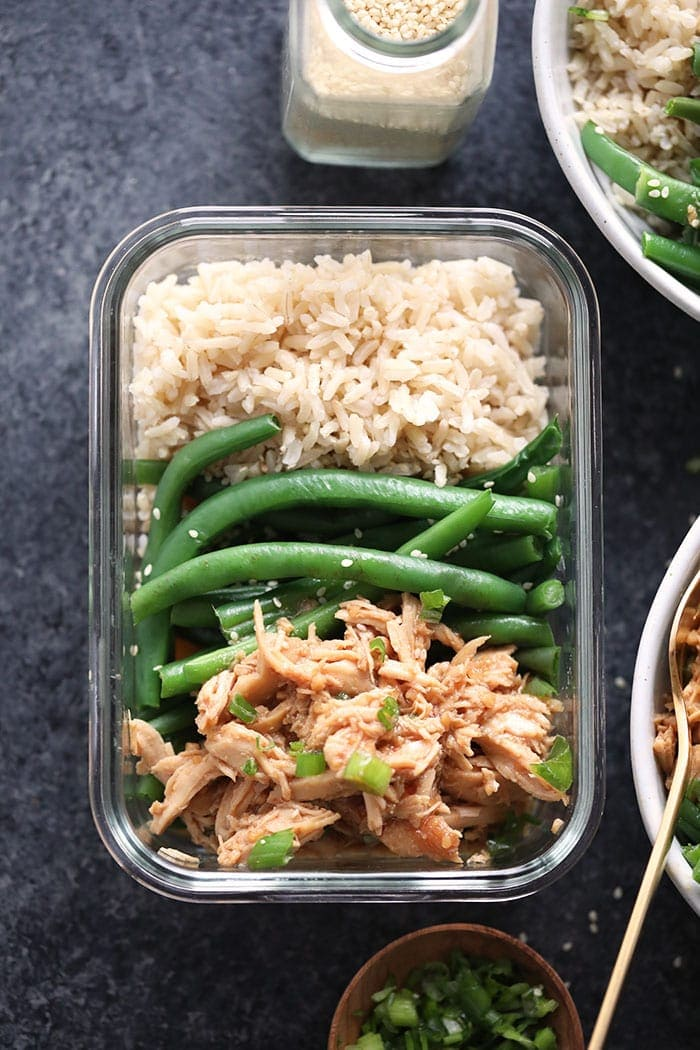 Honey garlic chicken with rice and green beans in a meal prep container.