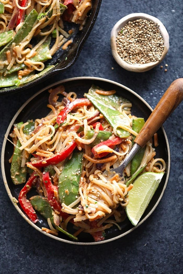 vegan pad thai with thai peanut sauce on a plate