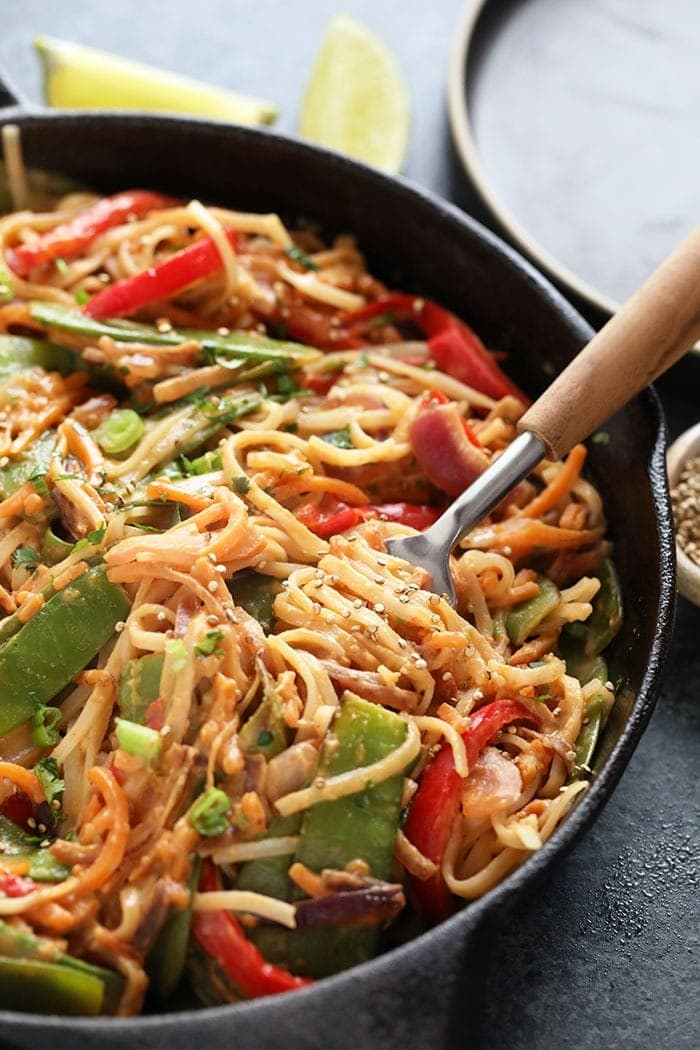 vegan pad thai with thai peanut sauce in a cast iron skillet