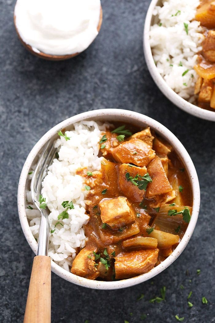 slow cooker healthy chicken tikka masala in a bowl with rice