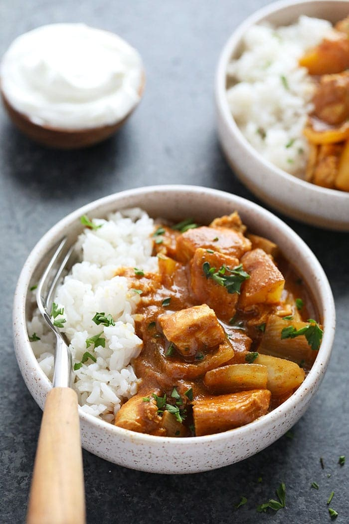 slow cooker chicken tikka masala in a bowl with rice