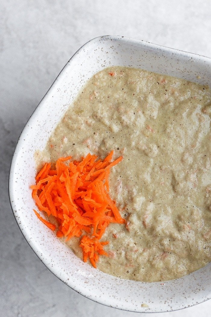 healthy carrot cake pancake ingredients in a bowl