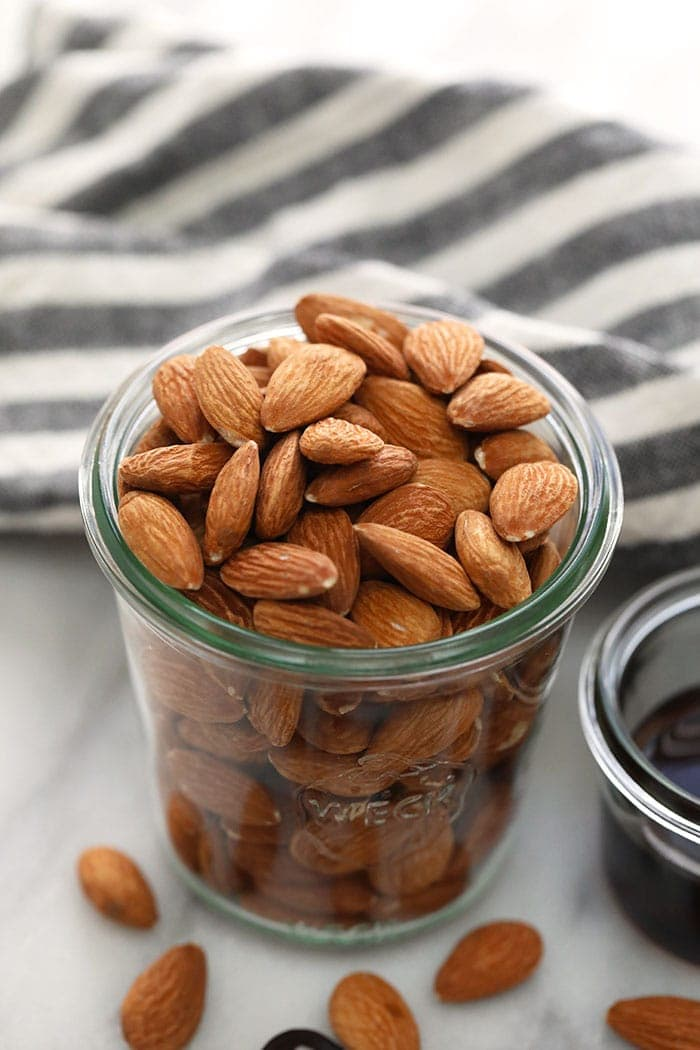 almonds in a jar ready to be roasted for almond butter