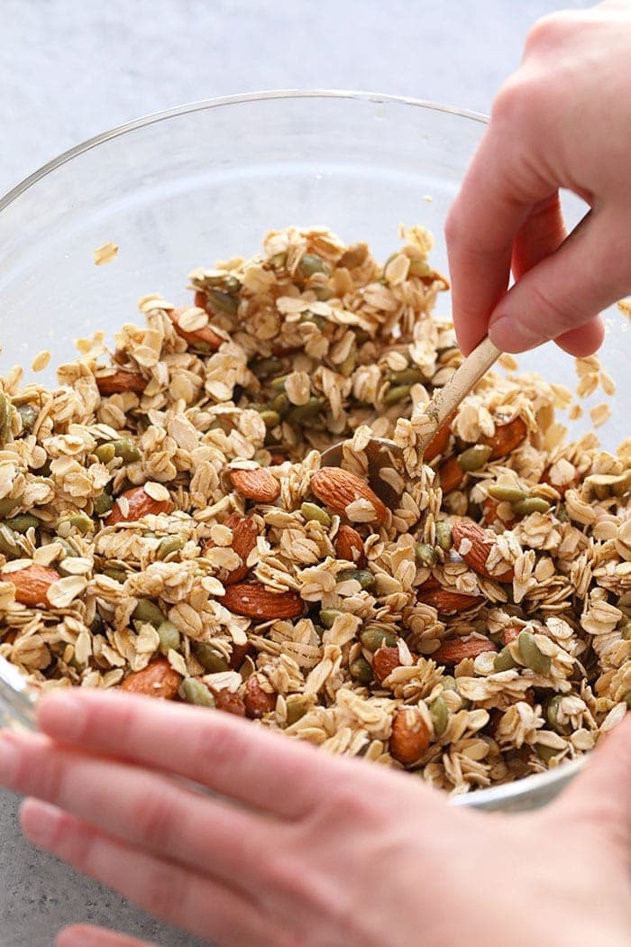 Mixing all the ingredients for healthy granola in a bowls