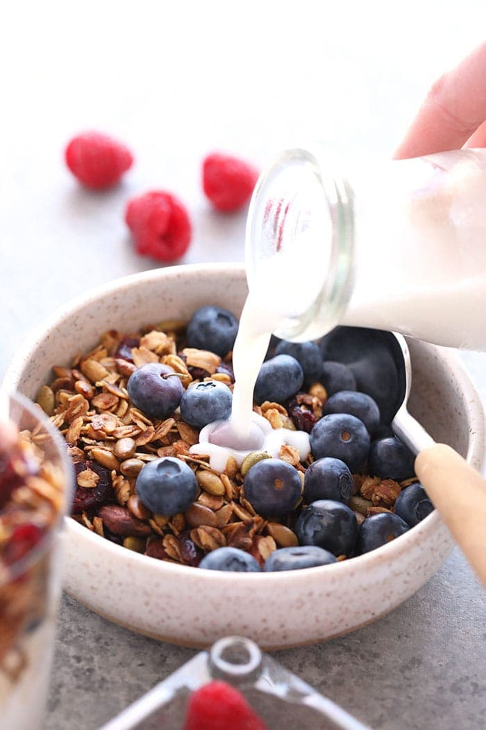 Granola in a bowl with milk and blueberries