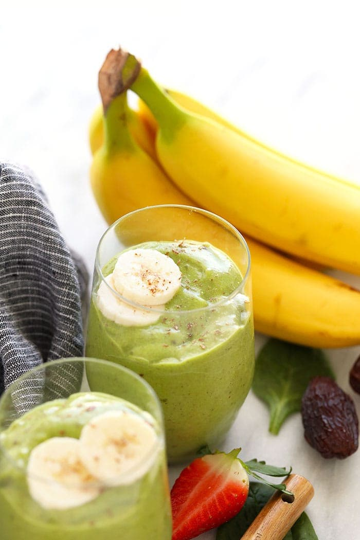 Green smoothies topped with bananas and flax