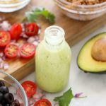 A jar of avocado cilantro lime dressing