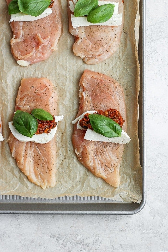 caprese stuffed chicken breast on a baking tray