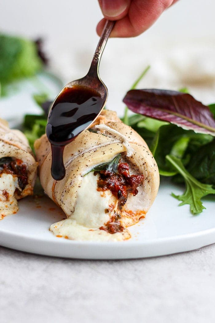 caprese stuffed chicken breast drizzled with balsamic glaze