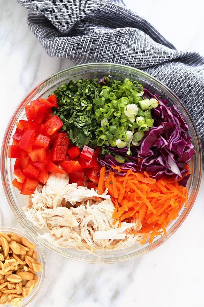 thai peanut chicken salad ingredients in a bowl