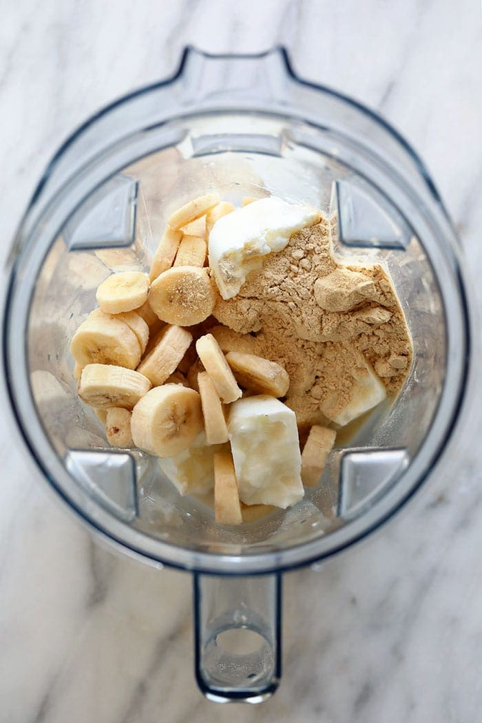 healthy banana protein shake ingredients in a blender
