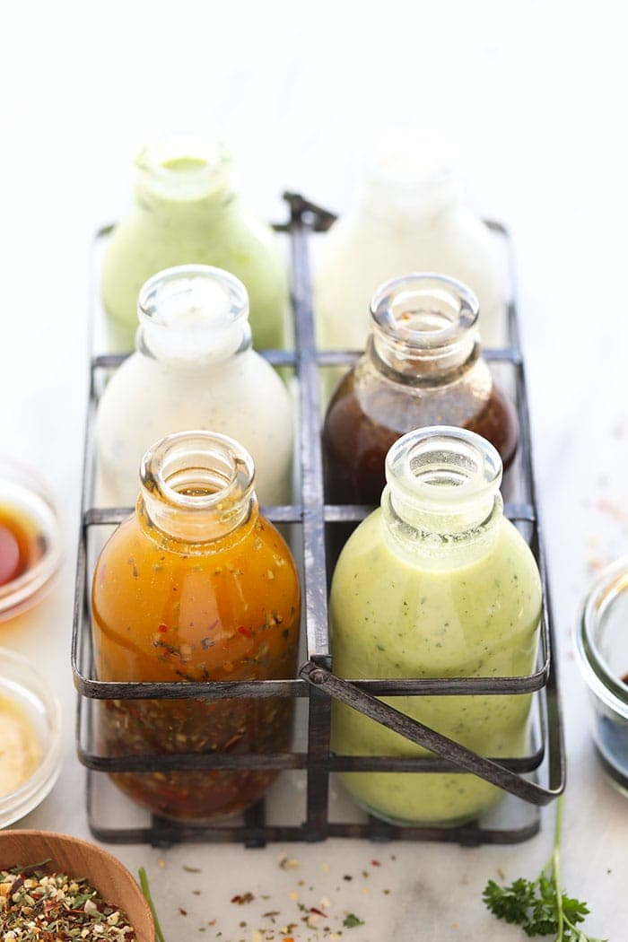 6 salad dressing recipes in a storage container
