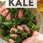 Two hands massaging kale