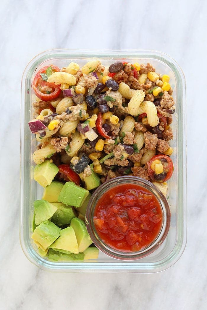 Meal Prep Container with taco pasta salad, avocado, and salsa