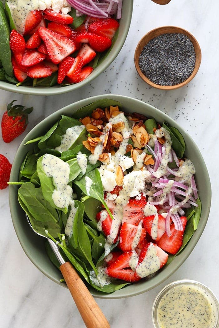 Strawberry spinach salad with poppy seed dressing in a bowl!