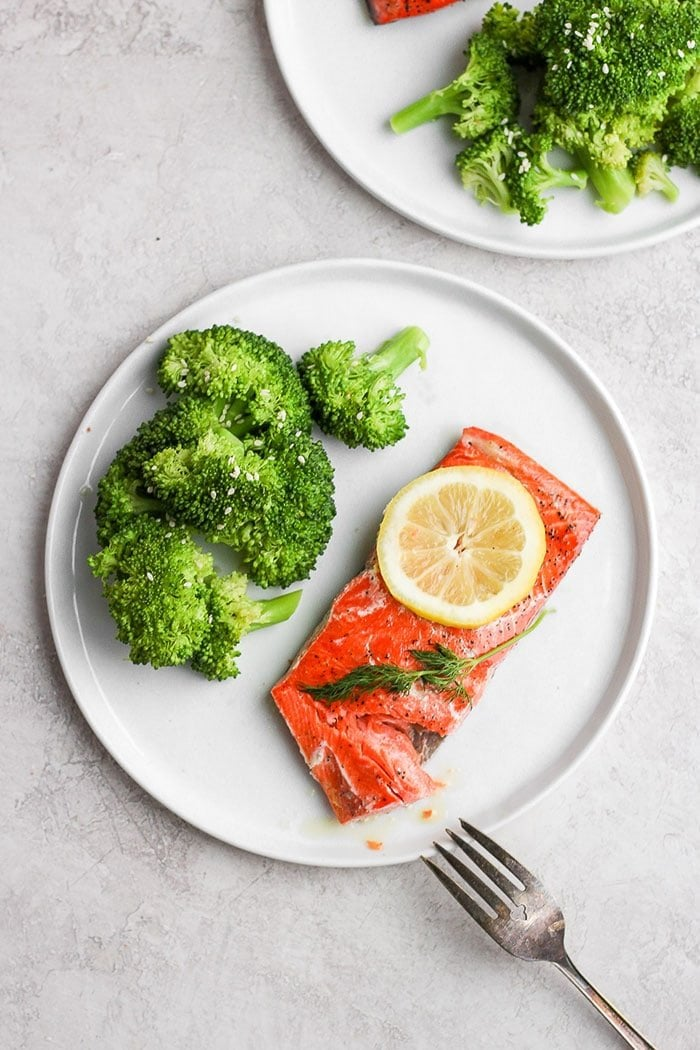 sous vide salmon on a plate with broccoli