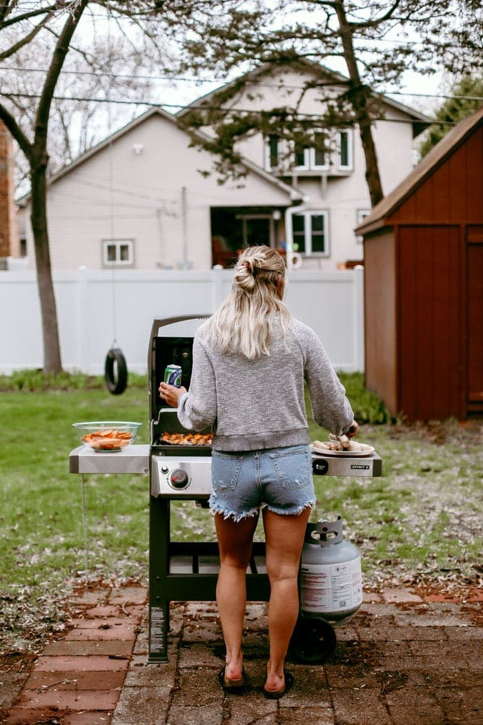 girl grilling with beer