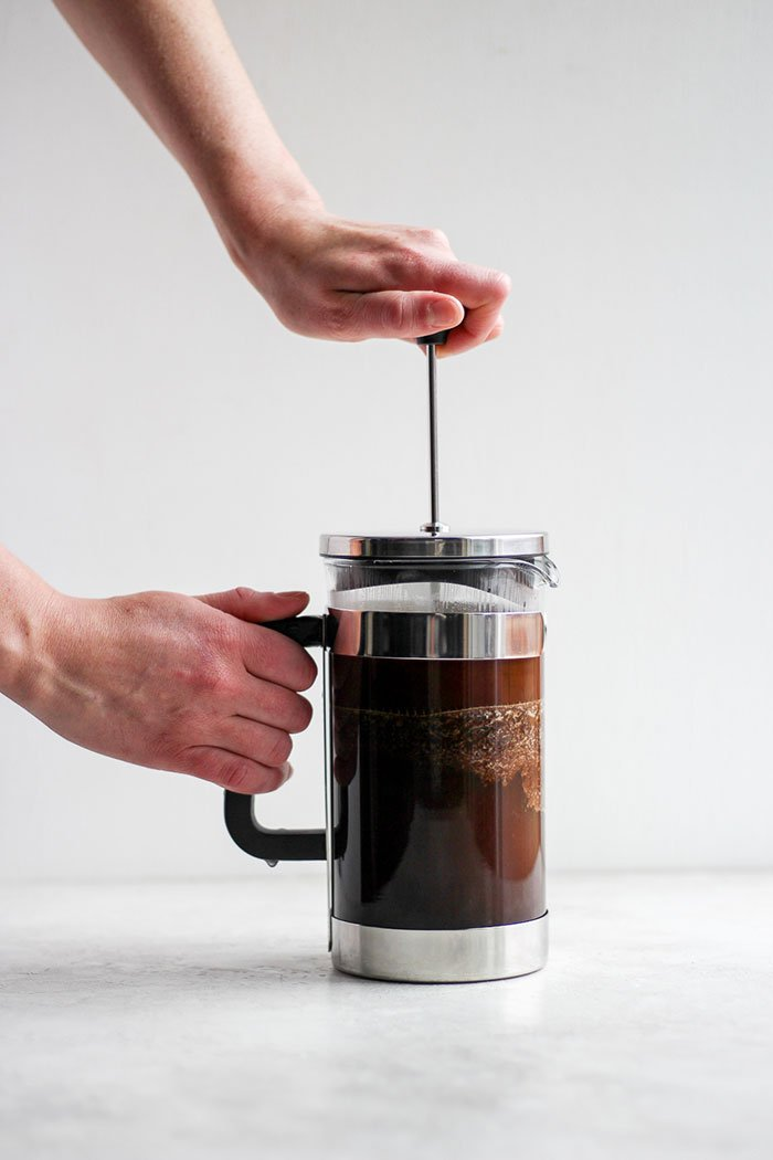 A pot of French press coffee brewing