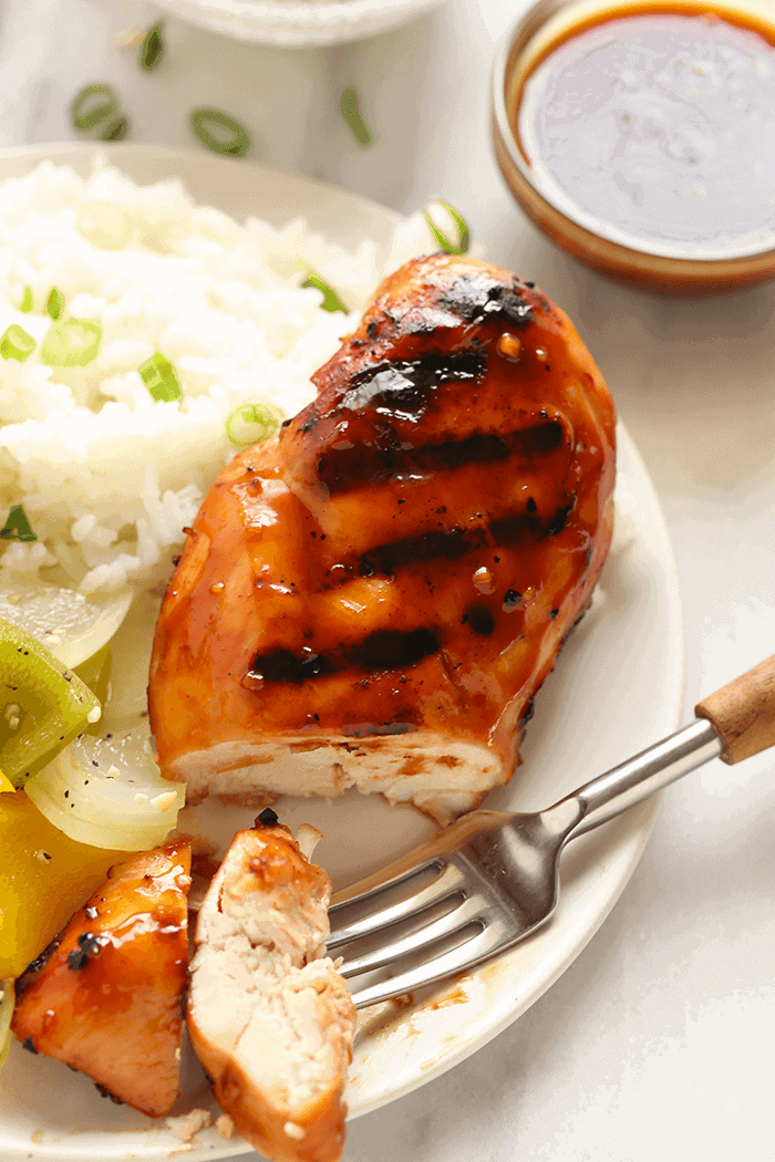 A sliced Teriyaki Chicken breast on a plate