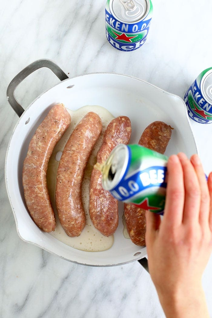 uncooked brats in pan