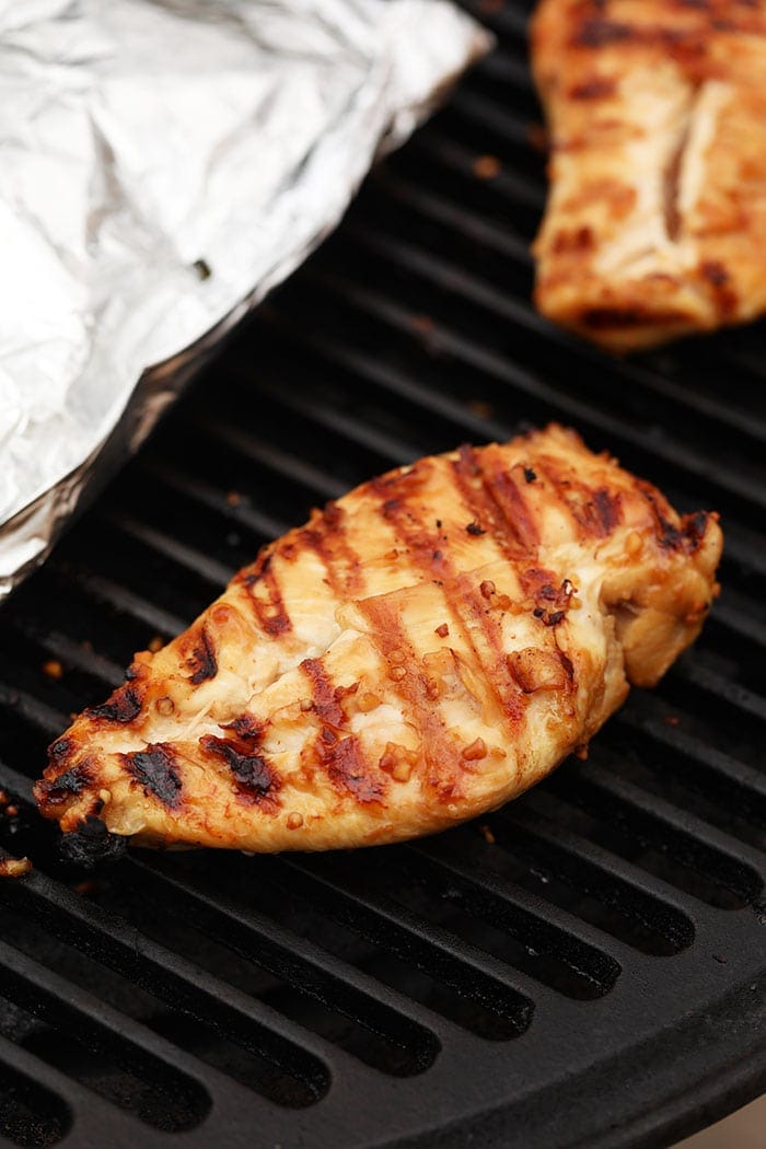 Grilled chicken breast on a grill