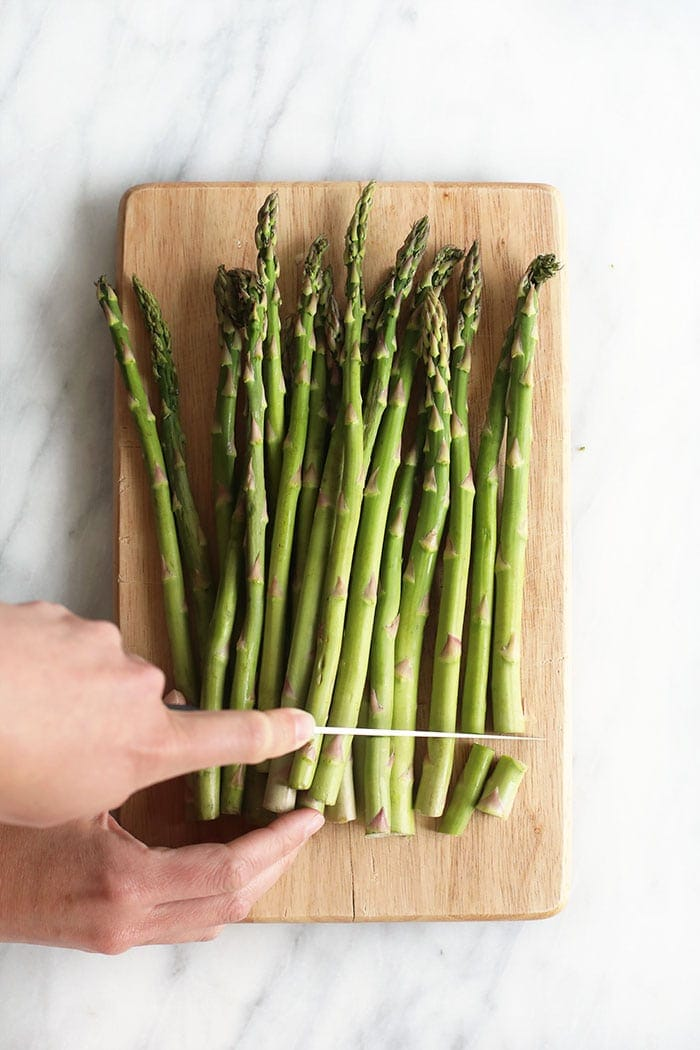cutting asparagus with knife