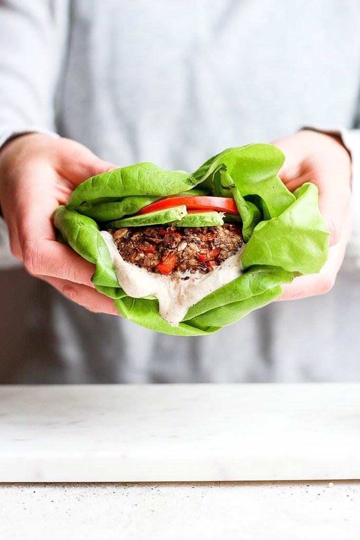 A black bean burger in butter lettuce