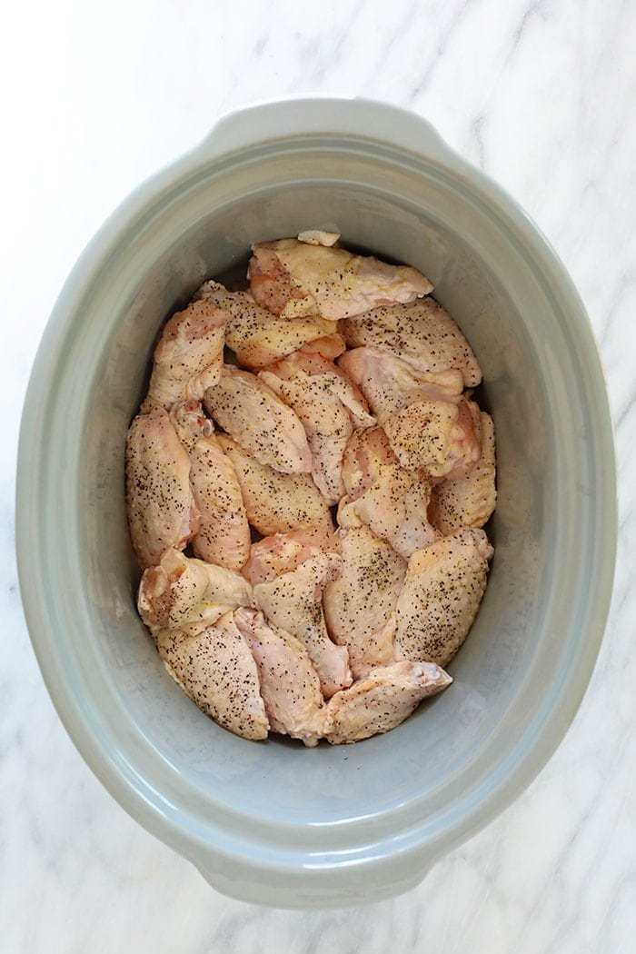 uncooked chicken wings in crockpot