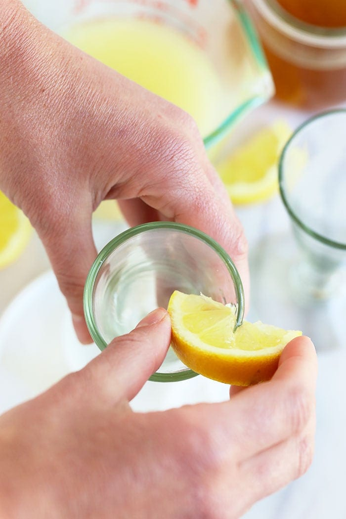 putting lemon juice on a martini glass rim