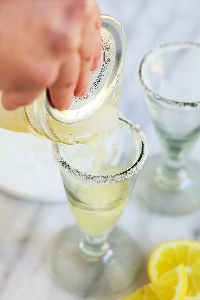 Pouring lemon drop into a glass