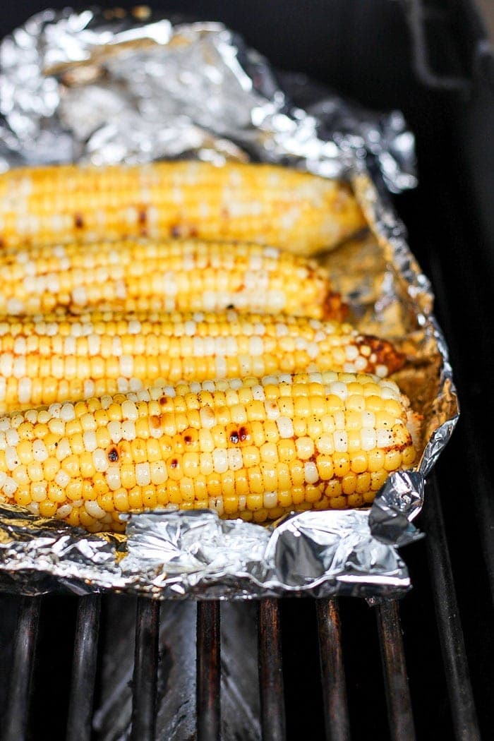 corn in tin foil on grill
