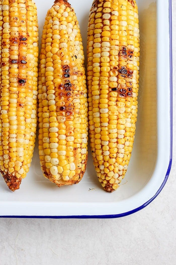 Grilled Mexican corn with chili powder