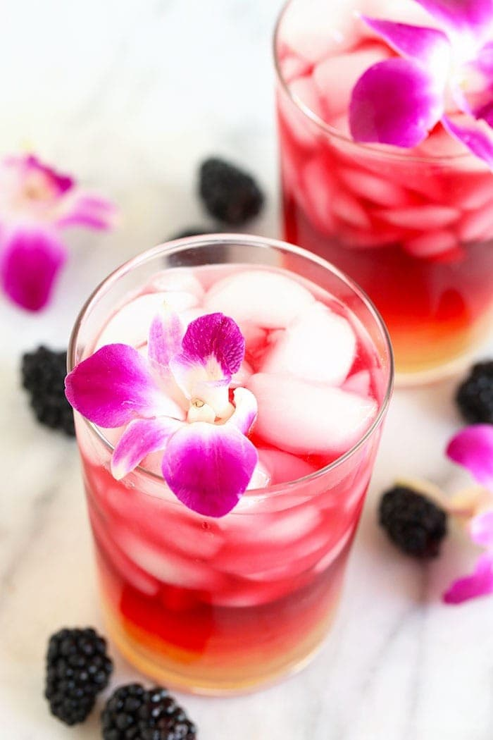 arnold palmer drink in a glass with an edible flower